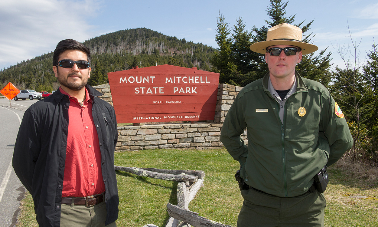A WCU student pictured in Mount Mitchell Park with a Park Ranger