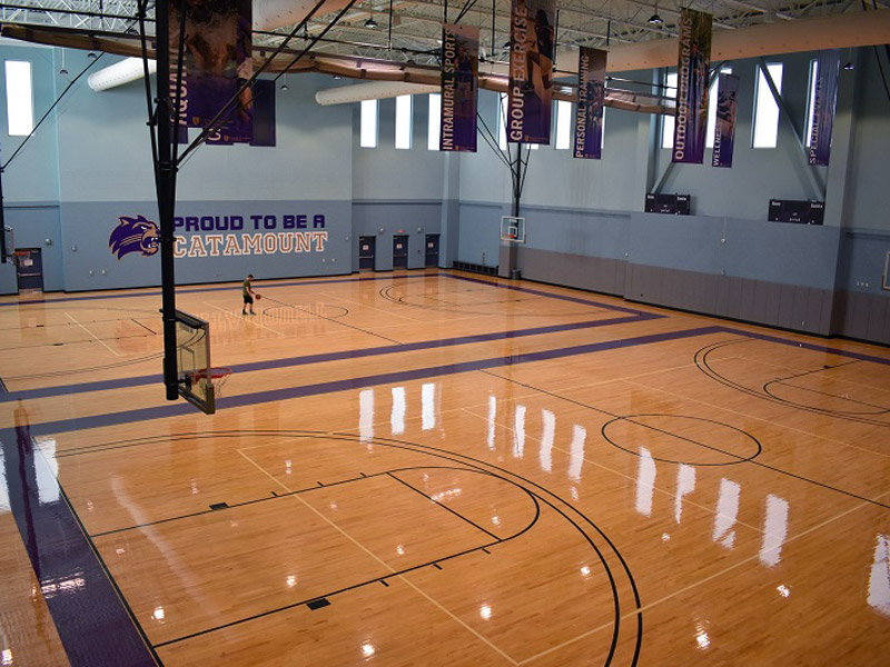 photograph of an indoor gymnasium and basketball court