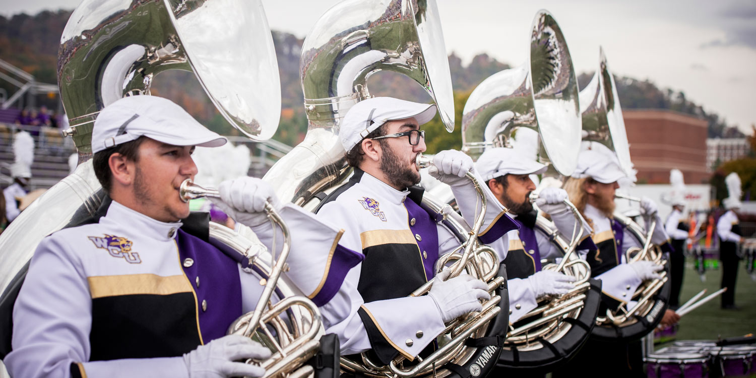 Marching Band students playing sousaphone