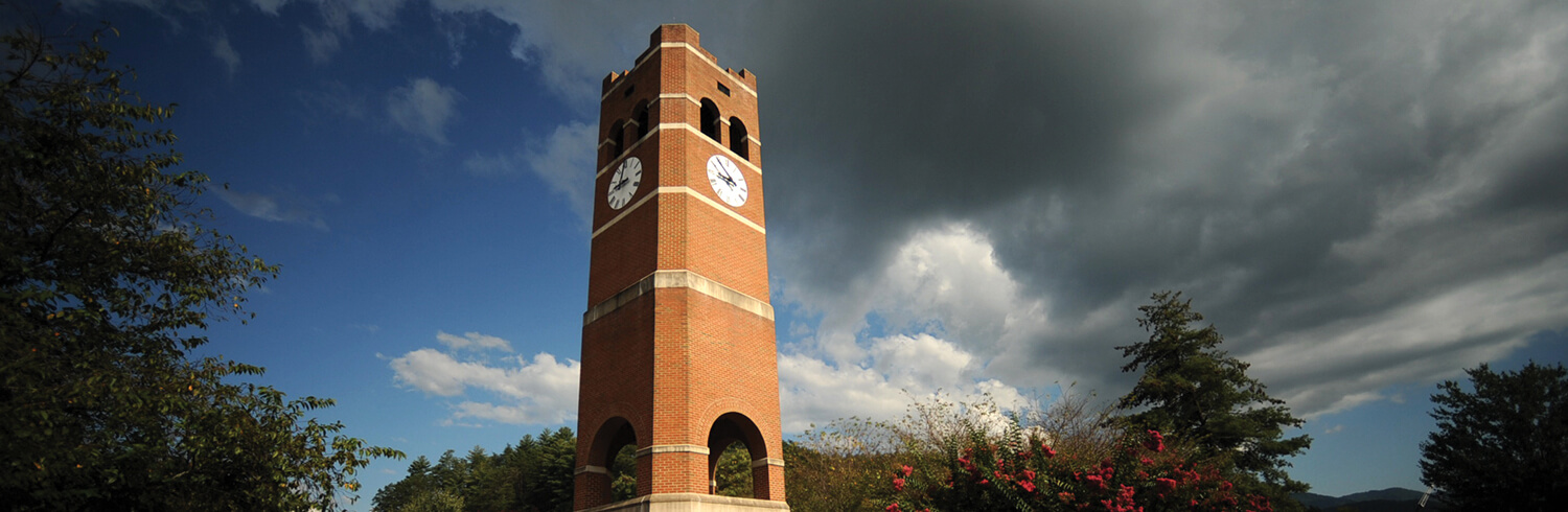 Photo of the Alumni Tower on campus as the background of a clickable button.